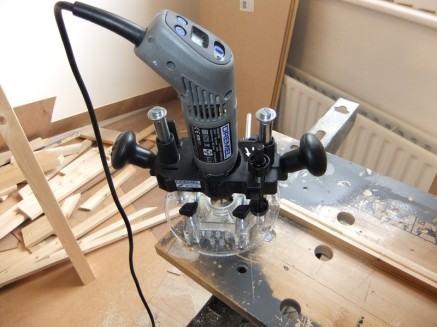 The hideously useful Dremel plunge router attachment