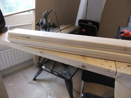 Two halves of a window post, with grooves for the perspex