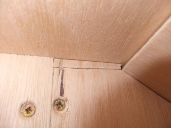 A small plywood shim to fill a gap